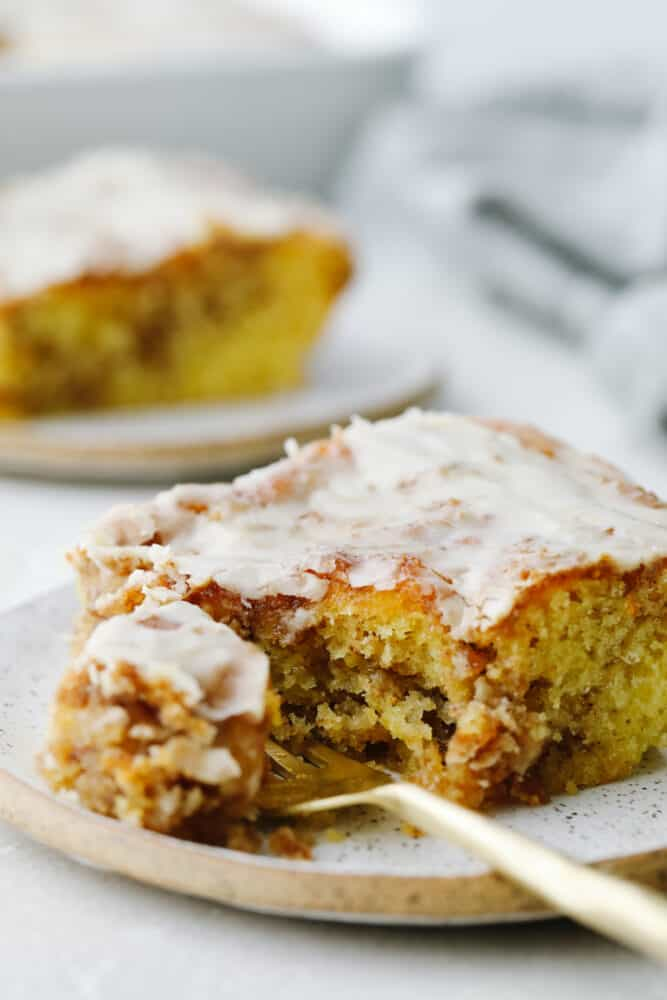 Honeybun cake being cut with a fork.
