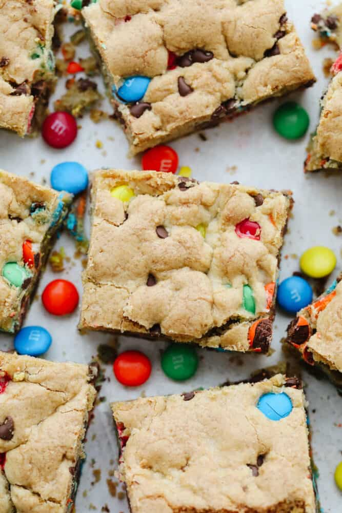Cut M&M bars sprinkled with candy.