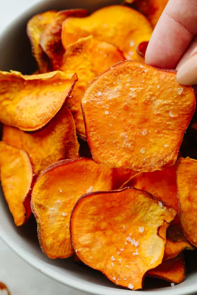 A close up of sweet potato chips.