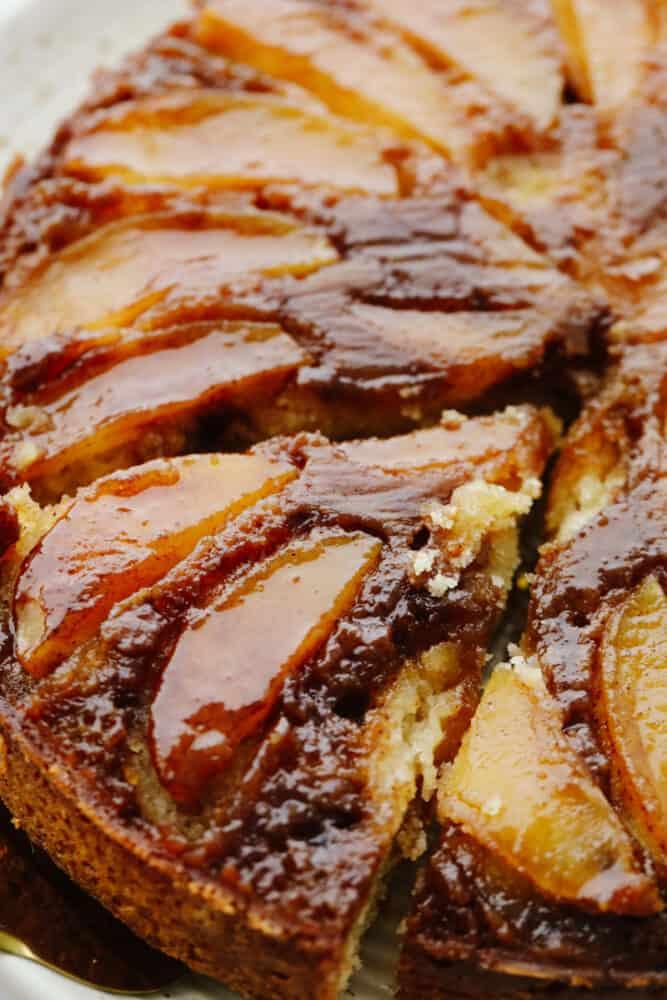 Close-up of a slice of apple cake with caramel glaze.