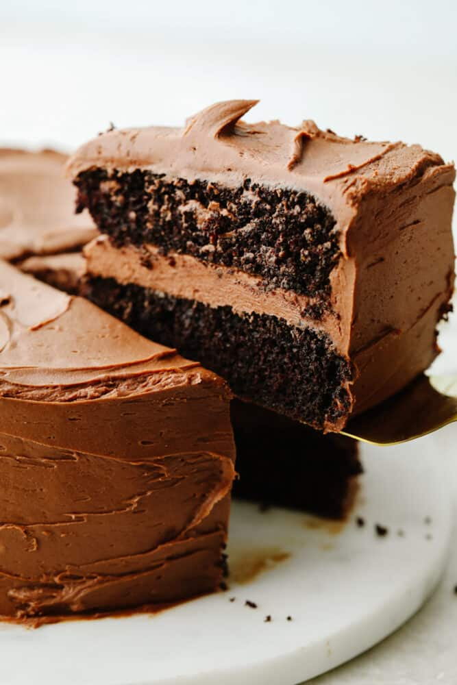 A slice of chocolate cake being served.