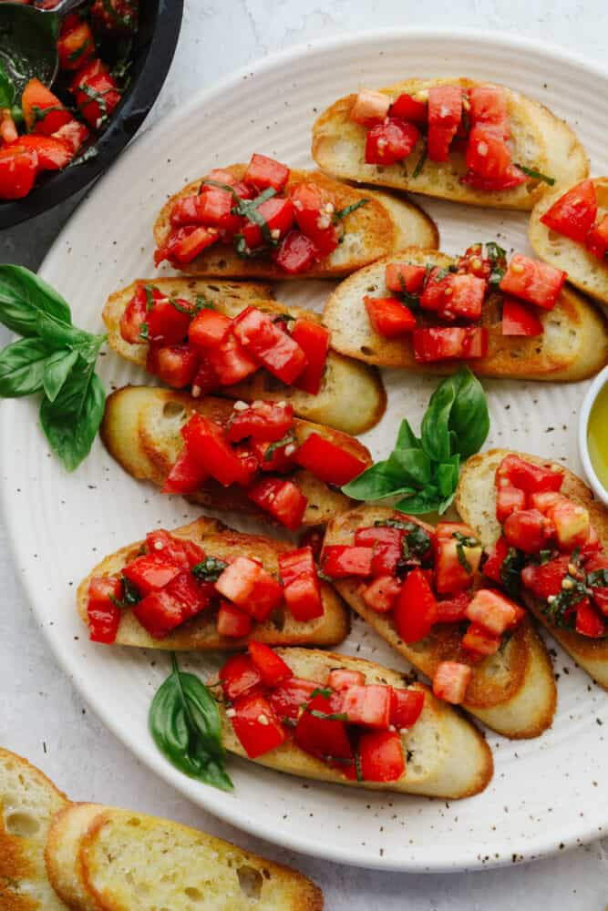 Crostini pieces topped with tomato basil salad.
