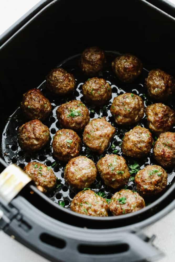 Meatballs in an air fryer.