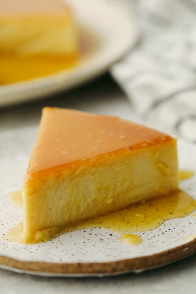 A slice of Flan cake on a white plate.