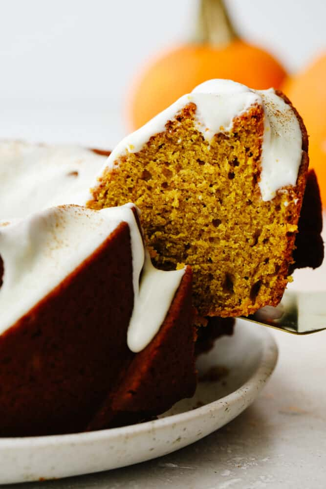Pumpkin slice being pulled out of the cake.